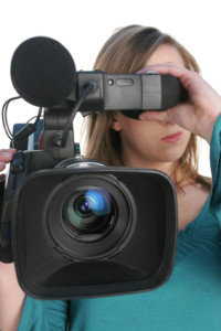 woman using video camera